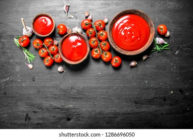 Fresh tomato sauce with spices and herbs. On black background.