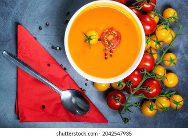 Fresh tomato soup served with cherry tomatoes and black peppercorns