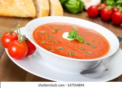 fresh tomato soup in a white bowl