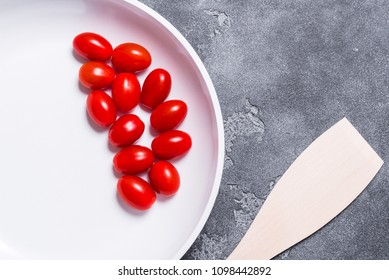 Fresh tomato in white ceramic pan