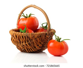 fresh tomatoes in a basket, isolated on a white background