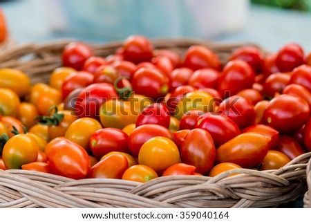 fresh tomatoes in basket, soft focus