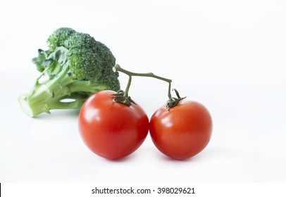 fresh tomatoes and broccoli isolated on white background