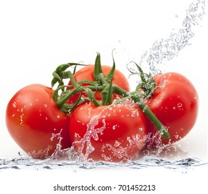 fresh tomatoes falling in pure water