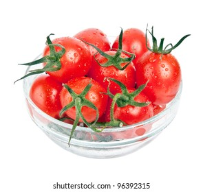 fresh tomatoes with green leaf in plate isolated on white background