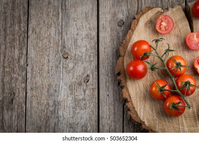 Fresh tomatoes on a branch. Tomatoes with water drops.tomato tomato