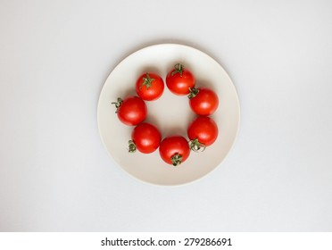 Fresh tomatoes on a plate. Concept of healthy eating. Diet.