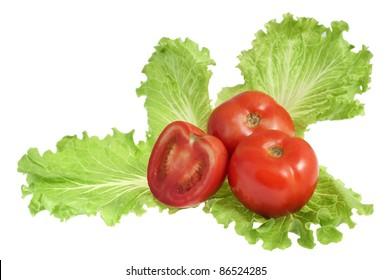 Fresh tomatoes on salad leaf isolated on white background
