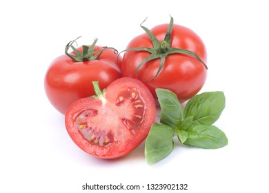 Fresh tomatoes on white ground