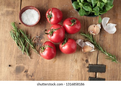 fresh tomatoes on a wooden cutting board
