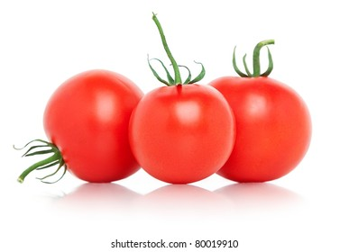Fresh tomatoes over white background.