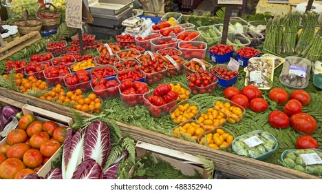 Fresh tomatoes for sale at a traditional Italian market. Concepts could include food, health, culture, travel, and others.