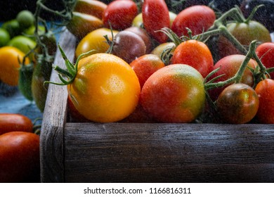 Fresh tomatoes in wooden crate