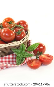 fresh tomatoes in a woven basket