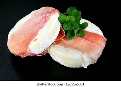 fresh tomini cheese with speck