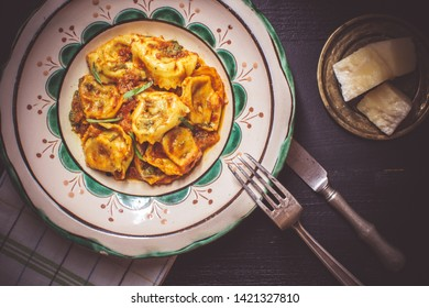 Fresh Tortellini with Tomato Sauce, Organic Mozzarella Cheese and Basil on Rustic Plate