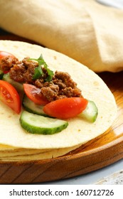 Fresh tortilla fajita wraps with beef and vegetables, Mexican food