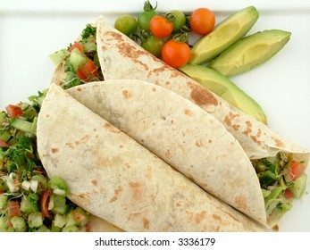 Fresh tortilla salad wrap with avocado and tomato