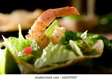 Fresh tostada with vegetables and shrimp.