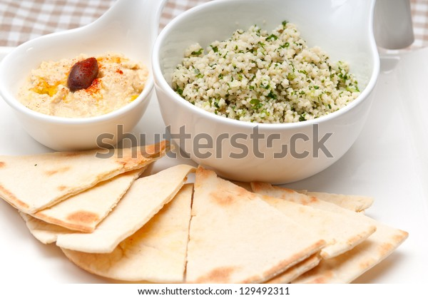 fresh traditional arab taboulii couscous with hummus