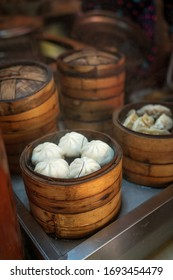 Fresh traditional Chinese steamed buns in bamboo steamers