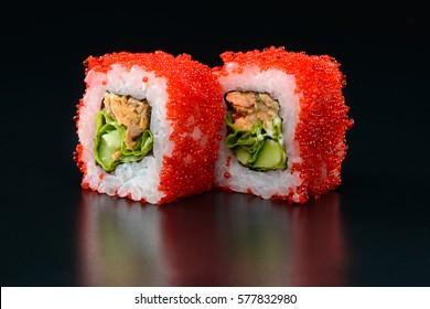 Fresh traditional Japanese sushi on black background