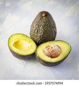 Fresh tropical avocado fruit close up on a table
