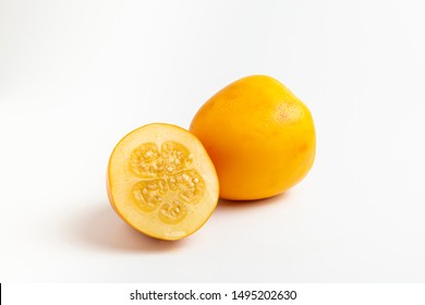Fresh tropical fruit: cocona, white background