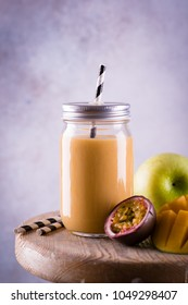 Fresh tropical fruit and vegetable smoothie with ingredients on retro background