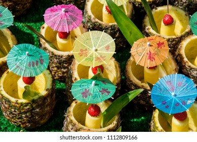 Fresh Tropical Pina Colada cocktail served in a pineapple - Summer Food Street Market
