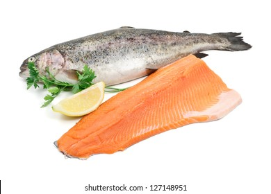 fresh trout and fillet with lemon and parsley over white background