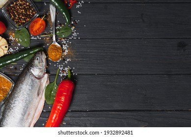 fresh trout with spices and seasonings top view, flat lay