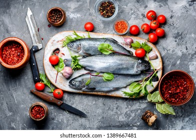 Fresh trout with spices and seasonings.Fish preparing for cooking.Seafood