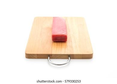 fresh tuna on wood board with white background