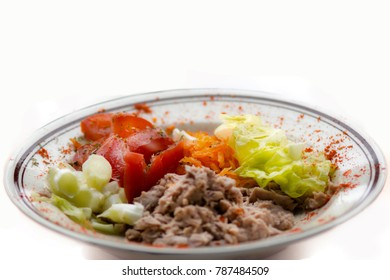 Fresh tuna and vegetables salad on white background,