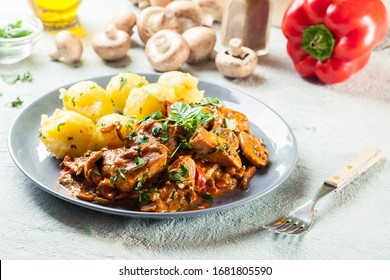 Fresh turkey ragout with mushrooms in creamy sauce with boiled potatoes