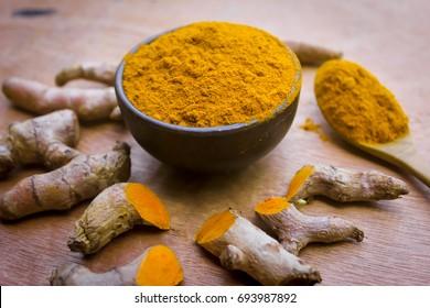 Fresh turmeric powder put on a wooden background