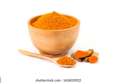 Fresh turmeric root ( known as curcumin, Curcuma longa Linn) and tumeric powder in wooden bowl  isolated on white background. Indian oriental low cholesterol spices. Medicine herbal plant concept.