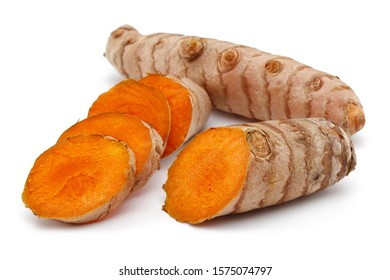 Fresh turmeric and slices isolated on white background