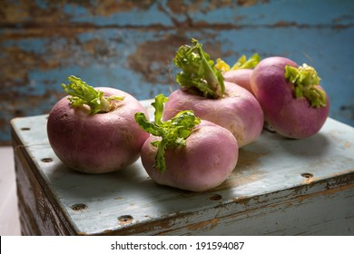 Fresh turnips on an old wooden box