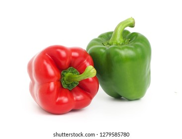Fresh two red and green bell peppers isolated on white background.
