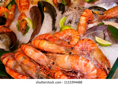 Fresh uncooked fishes with vegetables