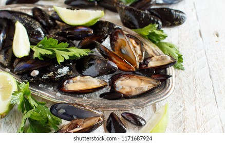 Fresh uncooked  italian mussels with lime and parsley