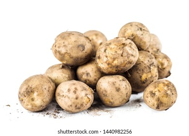 Fresh unpeeled organic new potatoes on white background.