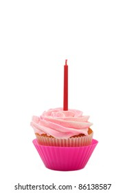 Fresh vanilla cupcake with rose buttercream icing and birthday candle on white background