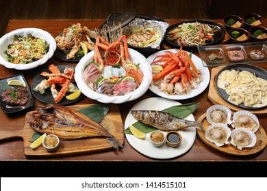Fresh variety of Hokkaido food, crab, hokke fish, salmon, sashimi, scallops, spaghetti, salad