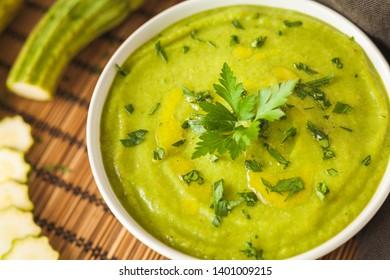 Fresh vegan plate of zucchini cream soup