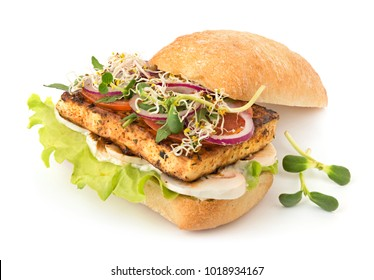 Fresh vegan sandwich with grilled tofu, vegetables and micro greens isolated on white with soft shadow