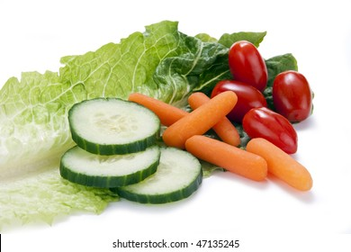Fresh vegatables (cucumbers, carrots, and cherry tomatoes) on a single leaf of Roamaine lettuce.