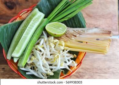 fresh vegetable in basket on wood background
